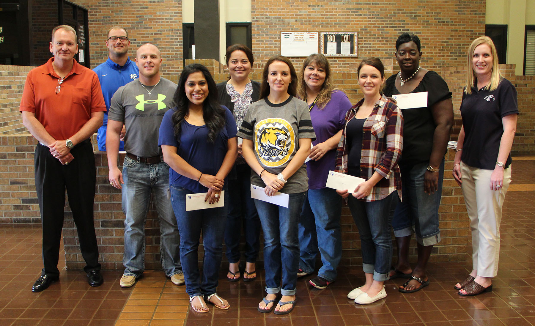 Mount Pleasant High School's First Year Teachers Received Grants From American National Bank. Pictured Are: Back Row (l-r): American National Bank President And CEO Brian Niblett, John Martin, Cody Russell, Angie Ayers, Sarah Fry, Shanta Lockett And Vikki Goates, ANB Executive VP And CFO. Front Row: (l-r); Noemi Ramirez, Brittney Crawford And Brittny Bobo. Not Pictured Katherine Dean, Bretteny Moore And Angela Priefert.