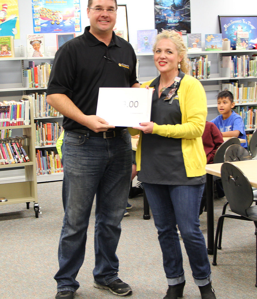 Fourth Grade Teacher Amanda Harper For The IXL Grammar Computer Program To Assist Students In Learning The Grammar Skills That Will Be Tested On STAAR