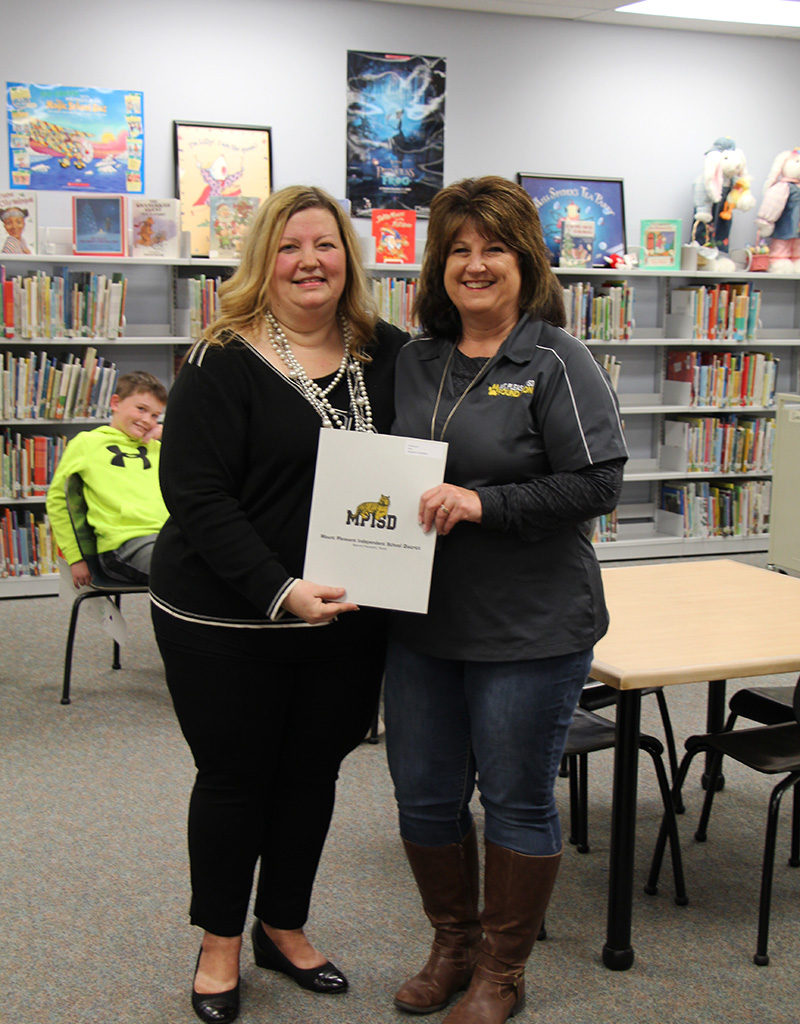 Principal Murray Accepts An Award For Teacher Stephanie Chambers For Sensory Play Materials, STEM Science Stations And Engineer-a-Cooster To Provide Hands-on Tasks That Are Academically Appropriate For Special Needs Students