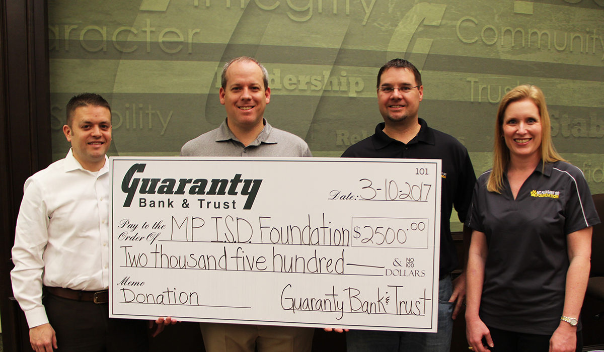 Pictured: MPISD Foundation Vice President Of Marketing Danny Muskrat, Guaranty Bank And Trust President Trent Abbott, Foundation President Brad Lowry And Foundation Treasurer Vikki Goates.